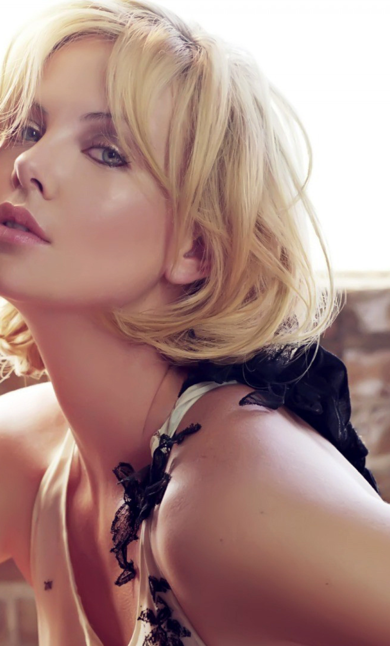 Download Charlize Theron Sexy Photoshoot 320x480