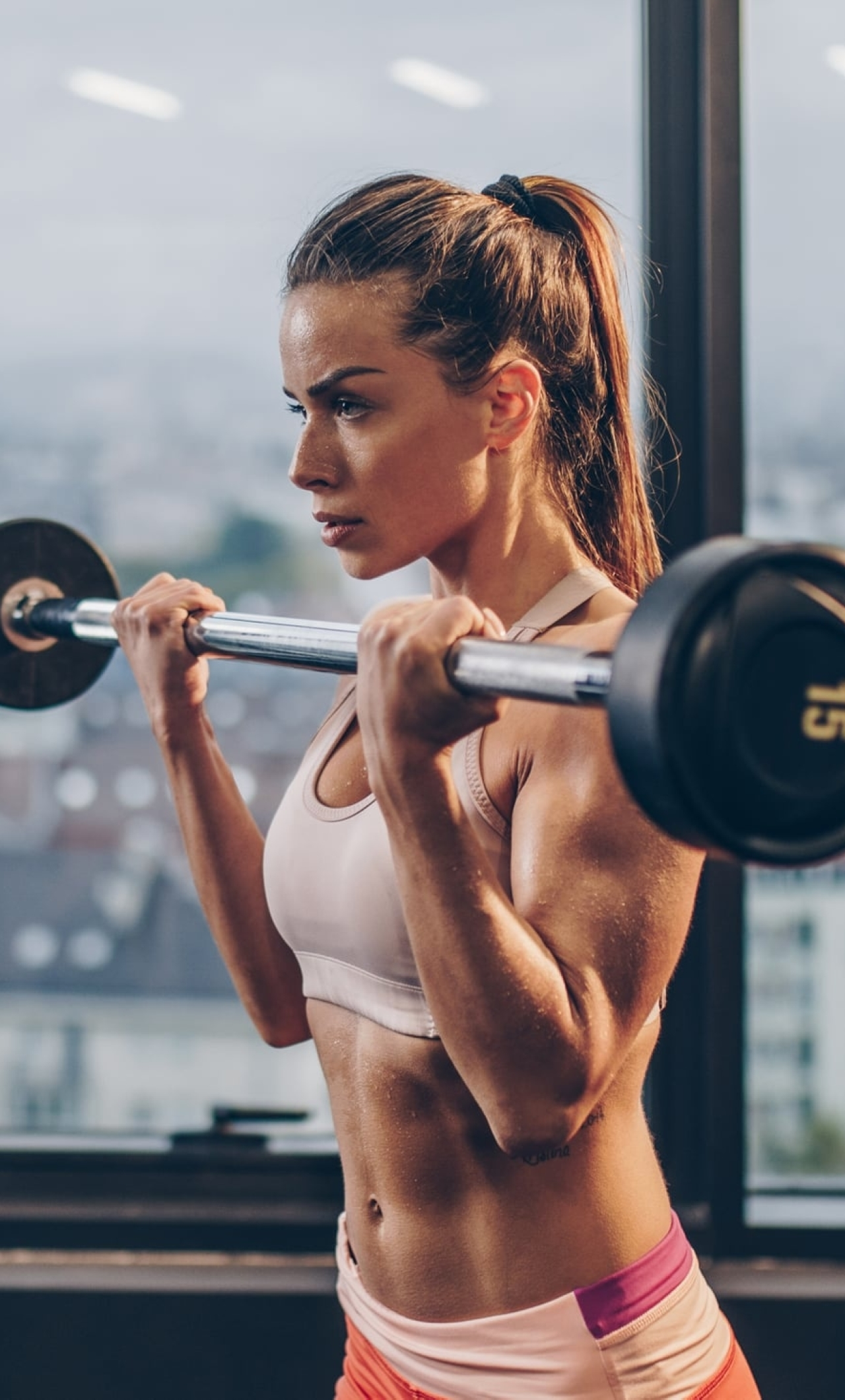 Girl Lifting Bar Wallpaper in 1280x2120 Resolution
