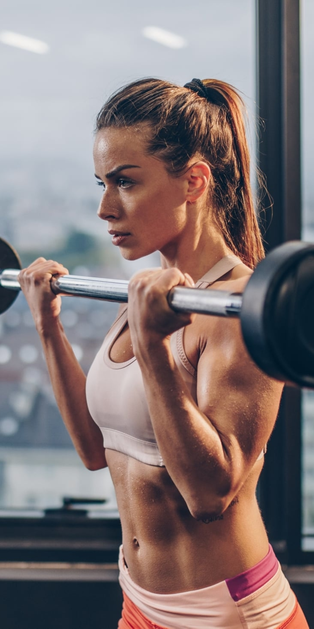 Girl Lifting Bar Wallpaper in 1080x2160 Resolution