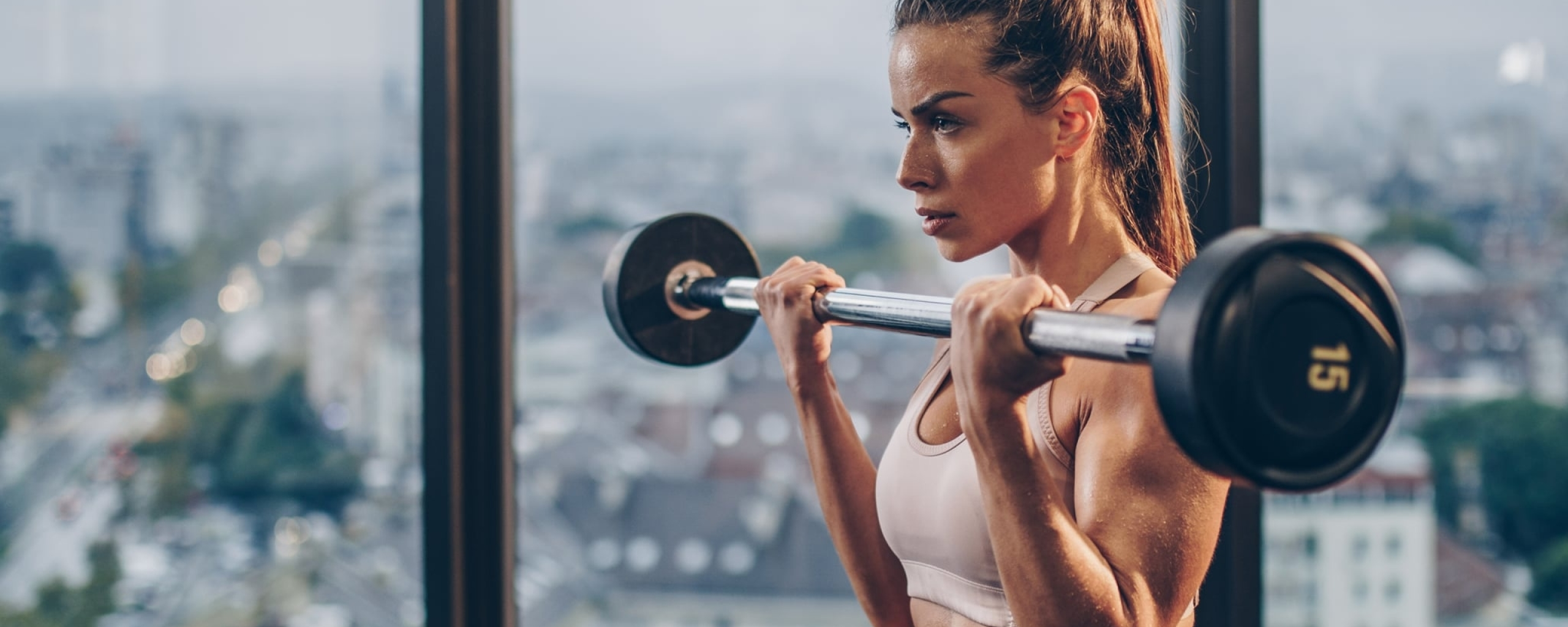 Girl Lifting Bar Wallpaper in 2560x1024 Resolution