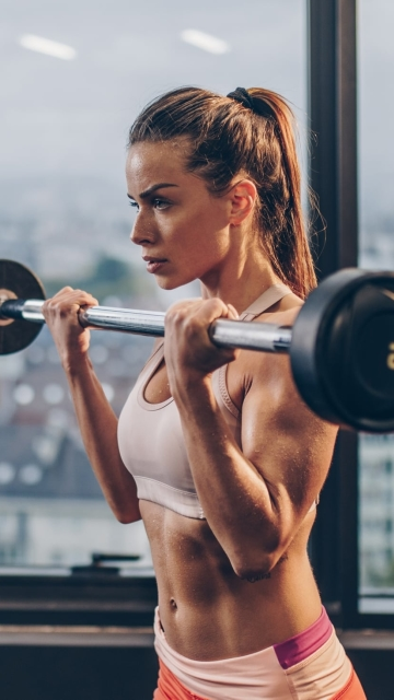Girl Lifting Bar Wallpaper in 360x640 Resolution