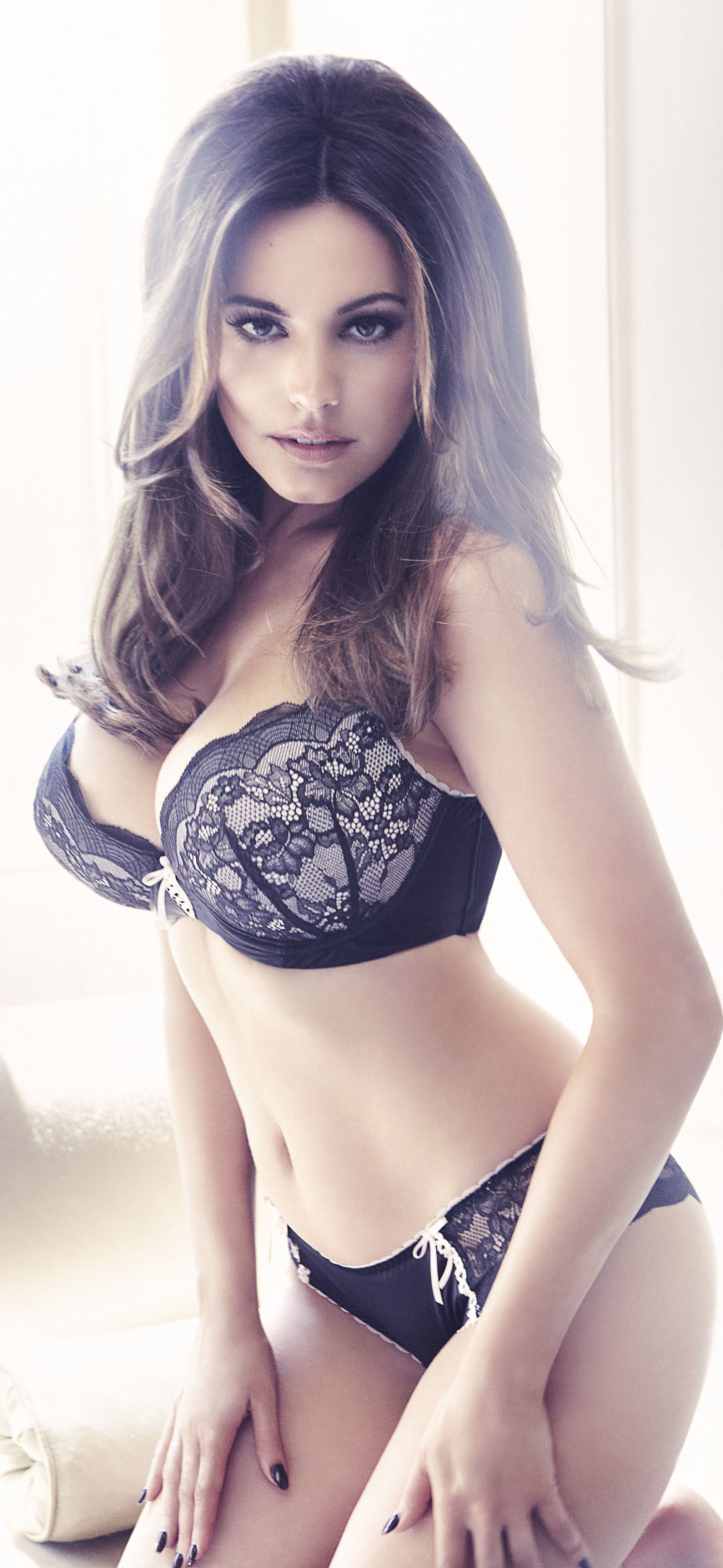kelly brook lingerie Kelly Brook comes up roses as she poses in lacy black lingerie