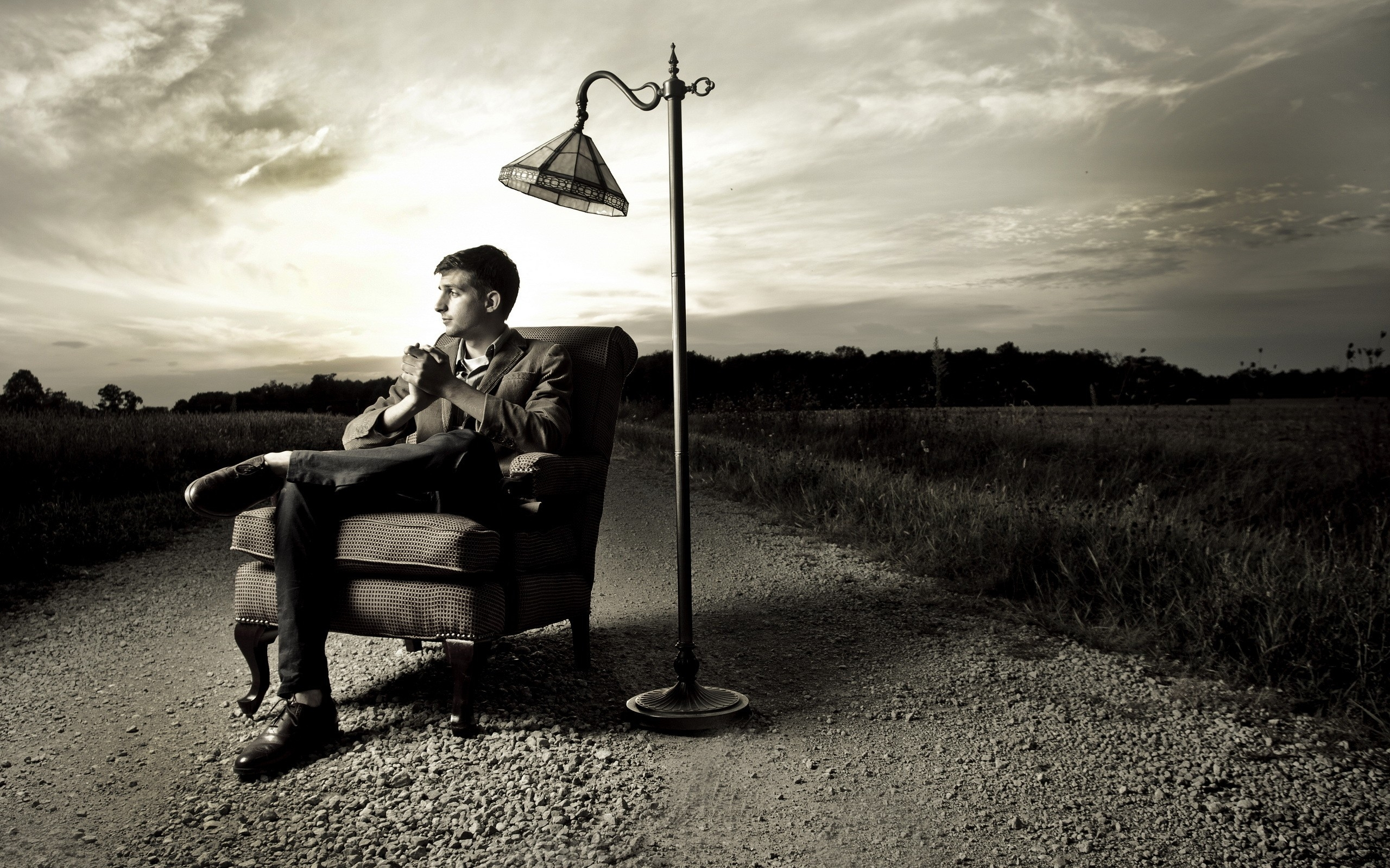 Man Sitting Chair Full HD 2K Wallpaper
