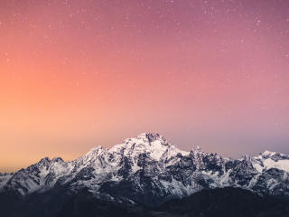 4K Starry Sky Above Snow Covered Mountains wallpaper