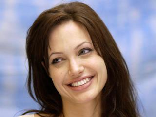 Angelina Jolie Cute Smile Photos wallpaper