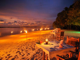 Dining on the Beach at Night in the Maldives Ocean wallpaper