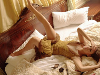 Eva Mendes Sexy Legs And Bed Wallpaper wallpaper