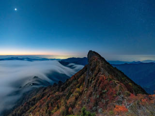 Fog Covering Horizon Mountains Under Blue Sky wallpaper