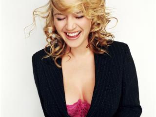 Kate Winslet smiley face wallpaper