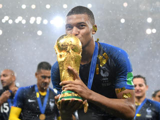 Kylian Mbappe Celebrates FIFA World Cup Win wallpaper
