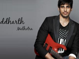 HD Wallpaper | Background Image Sidharth Malhotra with Guitar wallpapers