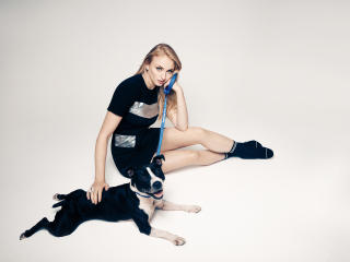Sophie Turner in Black Dress with Dog wallpaper