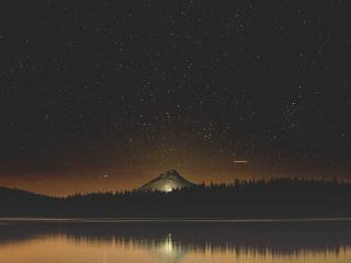 Starry Night Sky Near Lake wallpaper