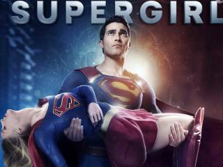 Superman saving Supergirl wallpaper