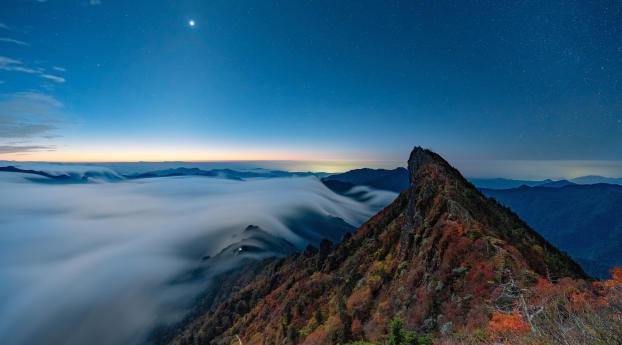 Fog Covering Horizon Mountains Under Blue Sky Wallpaper 800x1280 Resolution