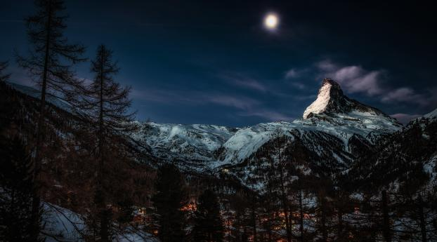 Moon at Pick of Winter Mountains Wallpaper