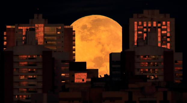 Moon Supermoon and Lunar Eclipse Wallpaper 1366x768 Resolution