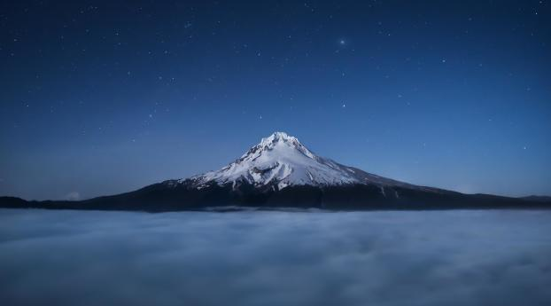 Mount Hood Above The Clouds At Night Wallpaper